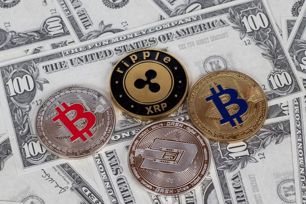 """""""Stack of cryptocurrencies"""" by marcoverch (licensed underCC BY 2.0)"""