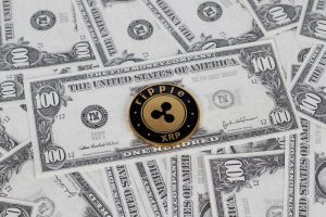 """""""Ripple coin and dollar bills""""bymarcoverch(licensed underCC BY 2.0)"""