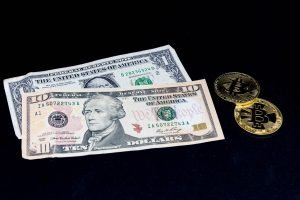 Why the US dollar and Bitcoin keep gaining global momentum