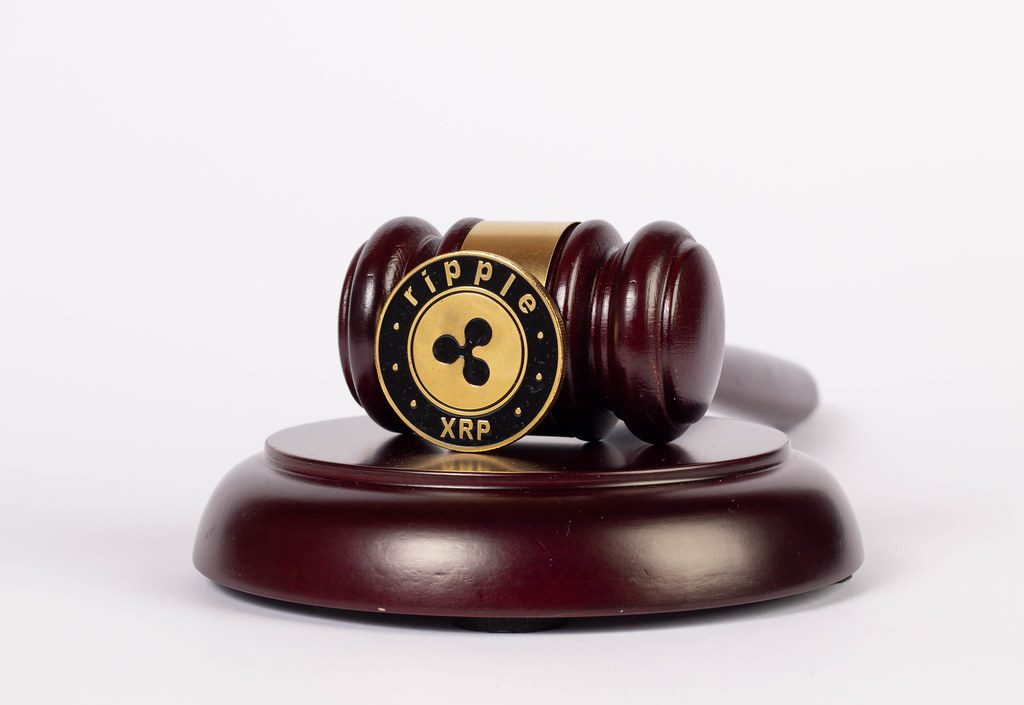 """""""Law gavel and Ripple coin""""bywuestenigel(licensed underCC BY 2.0)"""